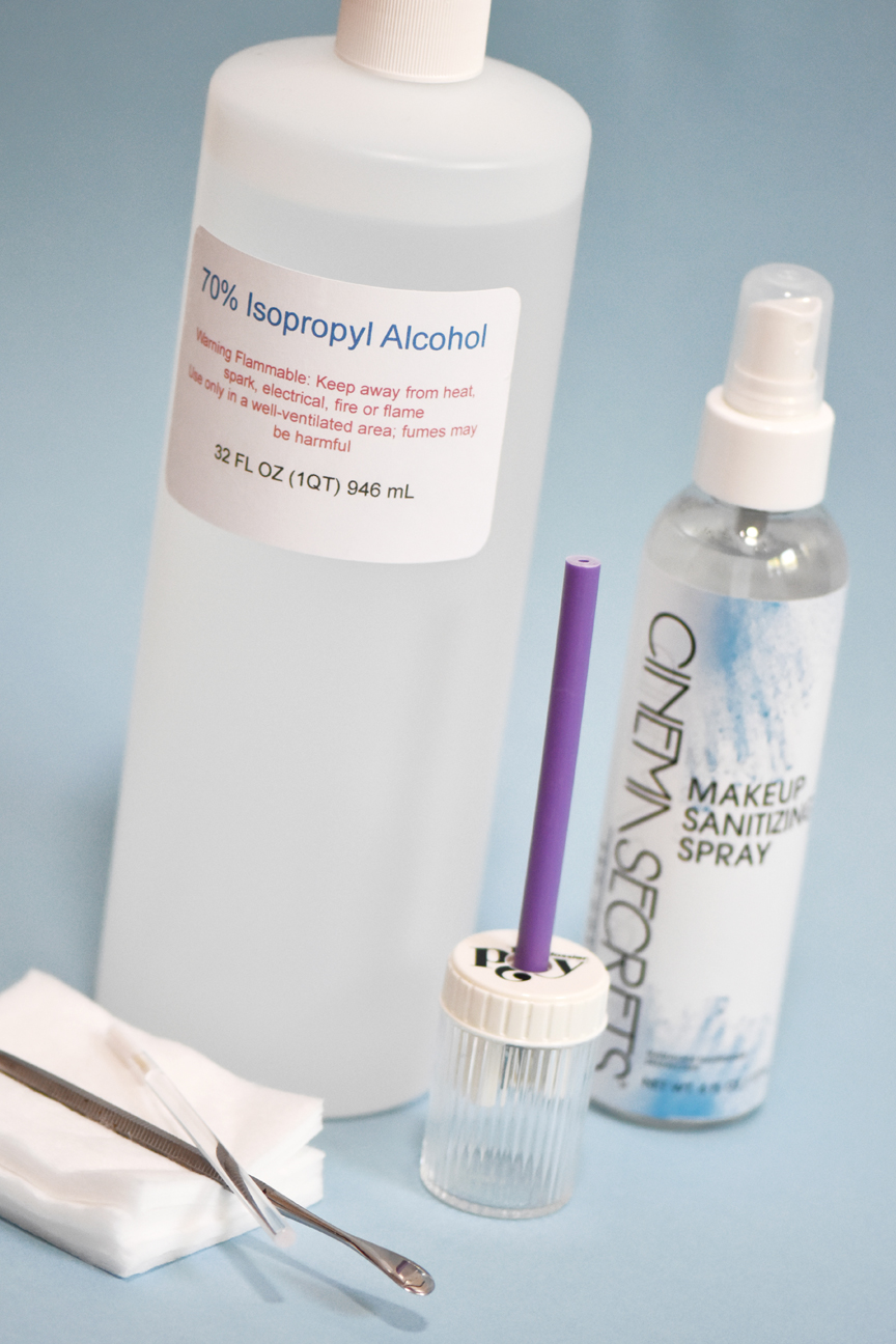 Alcohol and other cleaning supplies used to sanitize beauty products